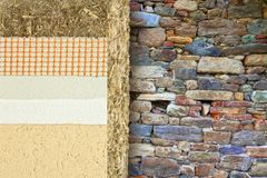 Thermal insulation coatings with hemp for building energy efficiency and reduce thermal losses against an old stone wall -. Building energy efficiency and royalty free stock images