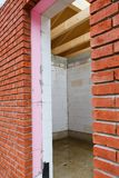 Thermal insulation. Cross section of a wall with thermal insulation stock photos