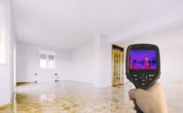 Thermal Insulation of the home. Heat Loss Detection of the House With Infrared Thermal Camera royalty free stock photos