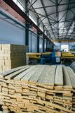 Thermal insulation sandwich panel production line for construction. Manufacturing storage with machine tools, roller conveyor. Industrial manufactory workshop stock images