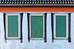 Thermal insulation on the wall of a new house. Thermal insulation on the wall of a new build house stock photography
