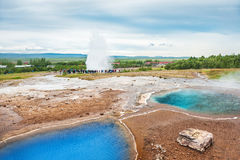 Thermal lake Blesi and eruption of Strokkur Geysir Royalty Free Stock Photos