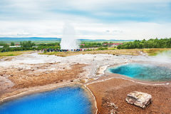 Thermal lake Blesi and eruption of Strokkur Geysir Stock Image