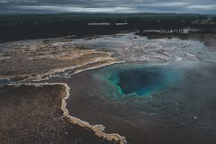 Thermal lake Blesi and Strokkur Geysir, Golden circle route. In south Iceland stock image