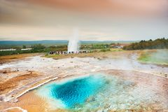 Thermal lake Blesi and Strokkur Geysir, Iceland Royalty Free Stock Photography