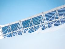 Thermal panel. Roof with thermal tubes during the winter covered with snow Royalty Free Stock Images
