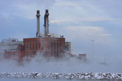 Thermal Pollution. Hot water from a coal burning electric power plant forms fog and steam on a subzero morning on the shore of Lake Erie Stock Photos