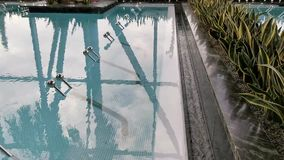 Thermal pool - bubbling water surface. And windows reflected in water stock video