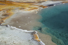Thermal pool with deep blue water and orange runoff, Yellowstone Royalty Free Stock Image