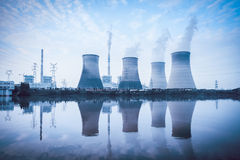 Thermal power plant. Cooling towers and reflection in the river Royalty Free Stock Photo