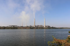 Thermal power plant emitting smoke constantly. Kota thermal power plant, across Chamble river, emitting smoke constantly and increasing pollution in the Stock Photos