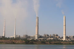 Thermal power plant emitting smoke constantly. Kota thermal power plant, across Chamble river, emitting smoke constantly and increasing pollution in the Royalty Free Stock Photography