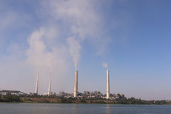 Thermal power plant emitting smoke constantly. Kota thermal power plant, across Chamble river, emitting smoke constantly and increasing pollution in the Royalty Free Stock Photo