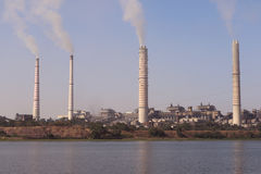 Thermal power plant emitting smoke constantly. Kota thermal power plant, across Chamble river, emitting smoke constantly and increasing pollution in the Stock Image