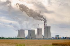 Thermal power plant with grain field. Cloudy sky stock photos