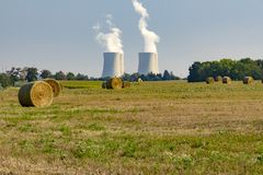 Thermal power plant with green field. With hay bales stock photos