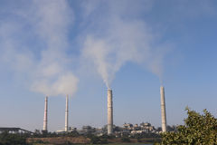 Thermal power plant. Kota thermal power plant, across Chamble river, emitting smoke constantly and increasing pollution in the environment Royalty Free Stock Photos