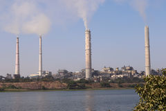 Thermal power plant. Kota thermal power plant, across Chamble river, emitting smoke constantly and increasing pollution in the environment Stock Images