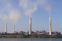Thermal power plant. Kota thermal power plant, across Chamble river, emitting smoke constantly and increasing pollution in the environment Stock Photo