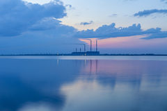 Thermal power plant and the lake at sunset Royalty Free Stock Images