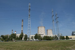 Thermal power plant. On the outskirts of the city on a sunny day Royalty Free Stock Photo