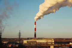 Thermal power plant pollution. Thermal power plant pollutes and degrades the environment Royalty Free Stock Photography