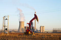 Thermal power plant and pumpjack Stock Images