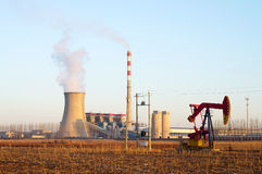 Thermal power plant and pumpjack Stock Image