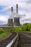 Thermal power plant's cooling tower. A working steam turbine power plant stock photography