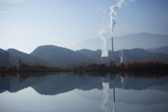 Thermal power plant with smoke and reflection Stock Photography