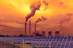 Thermal power plant with solar panels, sunset sky Stock Images