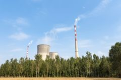 Thermal power plant and trees Royalty Free Stock Photography