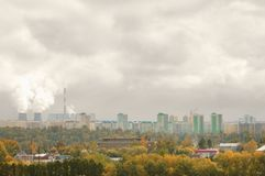 Thermal power station in the city in the autumn and smog the air stock photography