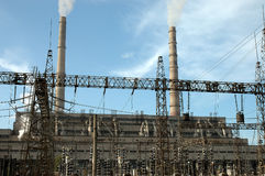 The thermal power station works. Smoke from pipes of a thermal power station Royalty Free Stock Photography