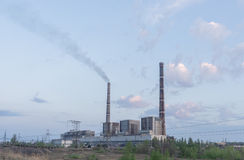 Thermal power stations and power lines on a clear day. Royalty Free Stock Photos