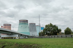 Thermal power stations and power lines on a cloudy day. Royalty Free Stock Image