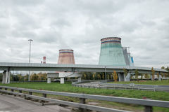 Thermal power stations and power lines on a cloudy day. Royalty Free Stock Photos