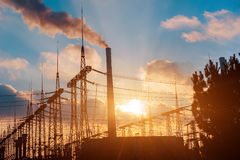 Thermal power stations and power lines during sunset. Stock Image