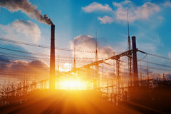 Thermal power stations and power lines during sunset. Royalty Free Stock Images
