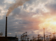 Thermal power stations and power lines during sunset. Stock Photography
