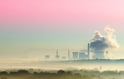 Thermal power. Surrounded by mist Stock Photography