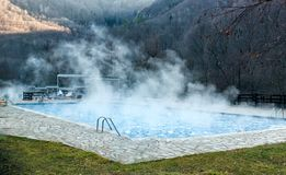 Thermal spring with swimming pool in mountain Stock Photography