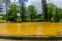 Thermal springs. Orange water, in Azores, Portugal. stock image