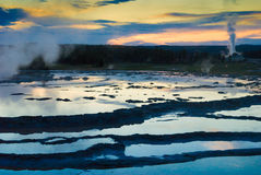 Thermal Sunset. Sunset reflects in Grand Fountain Geyser stock image