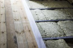 Thermal and vapor barrier insulation of the floor in the frame house construction Stock Photo