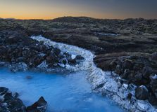 The thermal water from the Blue Lagoon in Iceland. The milky thermal water from the Blue Lagoon in Iceland at dusk stock photos