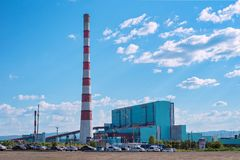 Thermal water-power plant against the blue sky. Beryozovskaya thermal power station GRES is located in the city Sharypovo, Krasnoyarsk Territory of Russia Stock Image