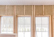 Thermally insulating eco-wood frame house with wood fiber plates and heat-isolating natural hemp material. Finishing the. Walls and a large window with a white stock image