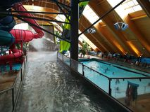 Therme Bucharest - Galaxy zone. Therme Bucharest - Galaxy special area for families with indoor slides and waves pool stock photography