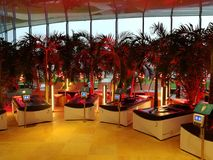 Therme Bucharest - hydromassage area. Loungers and palm trees royalty free stock images